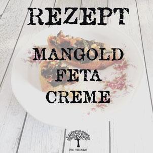 Mangold Feta Creme auf Baguette und Ciabatte auf Teller auf Holztisch